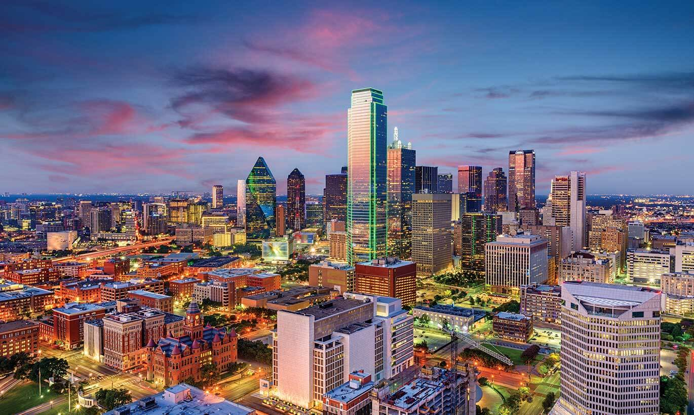 The Dallas skyline lit up in the evening