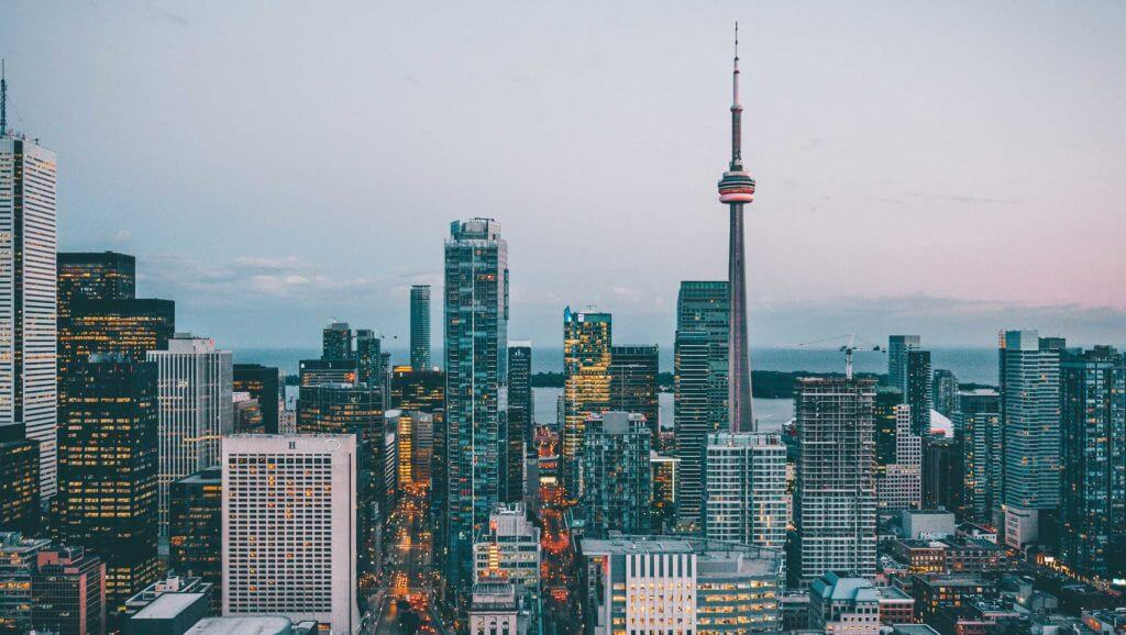 The Toronto skyline in Ontario, Canada. Multiple Canadian companies do business with Texas.