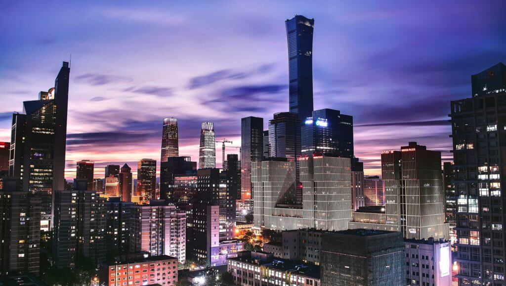 Tall, brightly-lit buildings reach into the sky in Beijing, China. China and Texas have a long history of foreign direct investment.