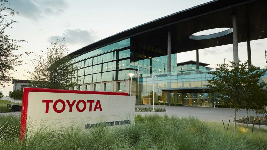 The exterior of the Toyota building features a large sign with the name of the company.