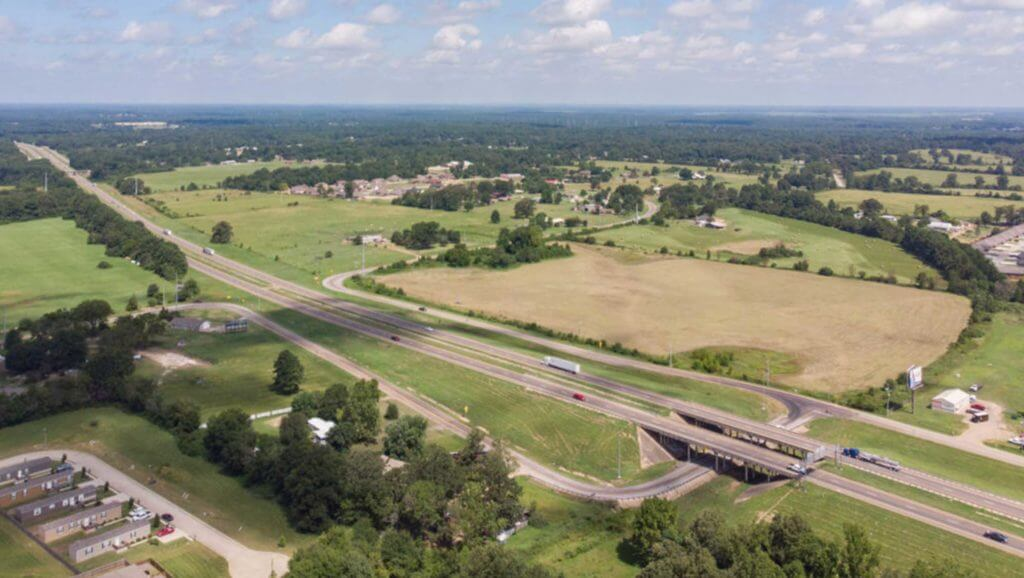 Aerial view of cars driving on major interstates in Texarkana, Texas.