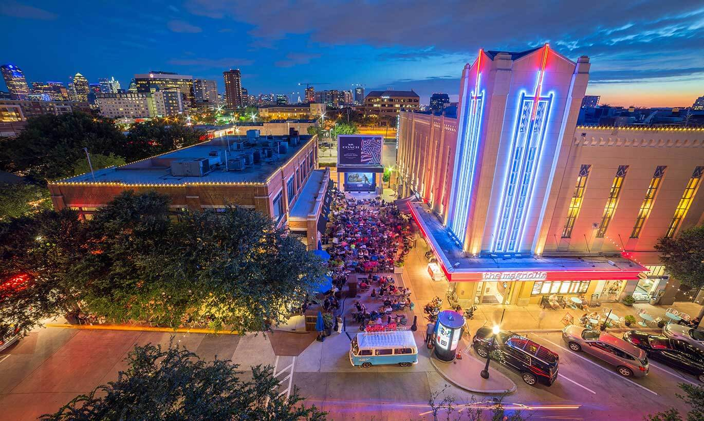 A crowd gathers for an outdoor movie night next to the West Village shopping mall in Dallas, Texas.