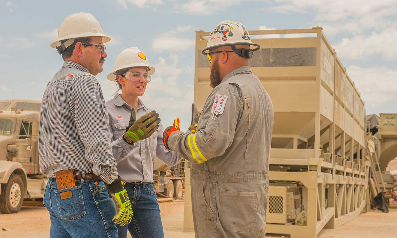 Two men and a woman working at Shell in Texas.