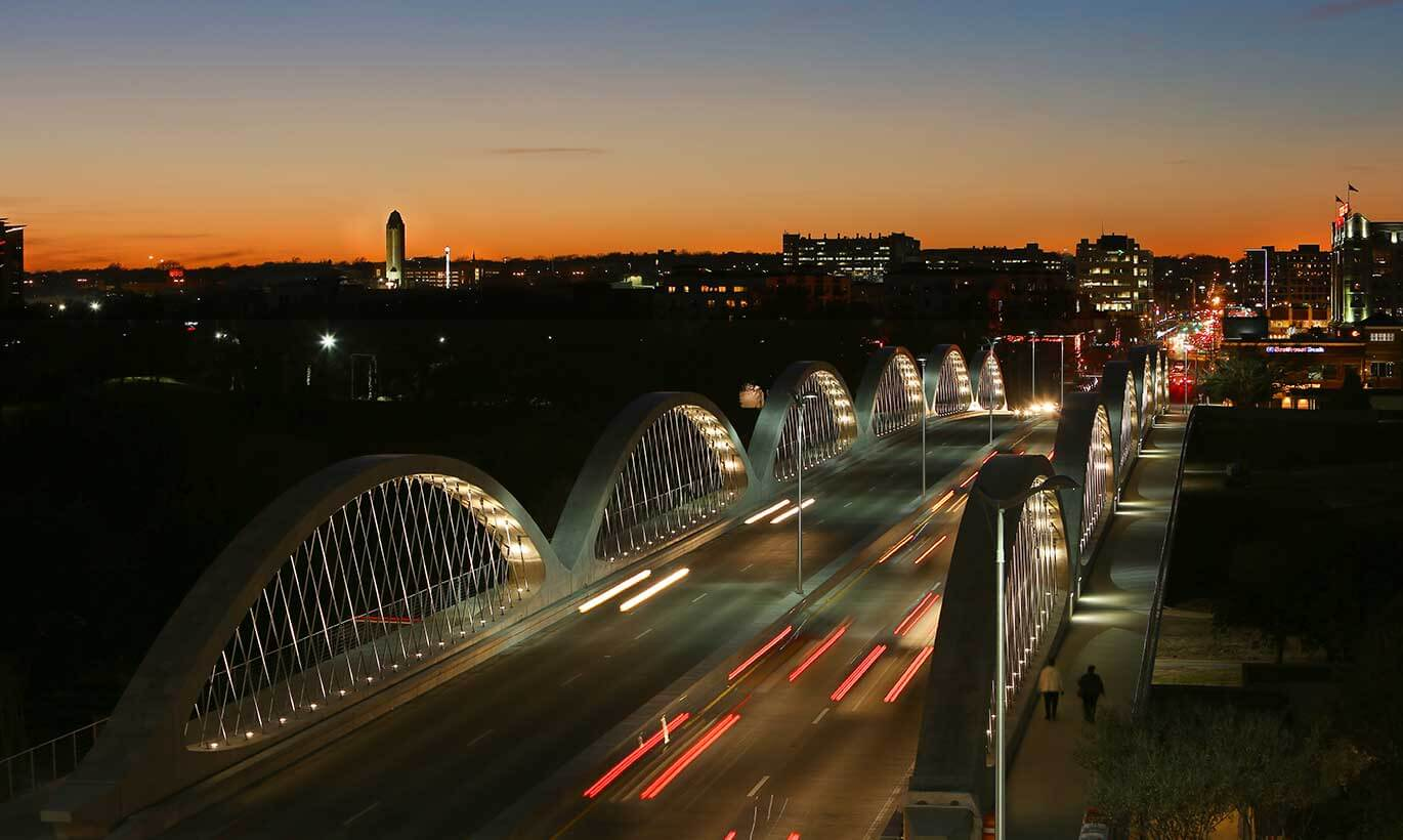 Cars drive on the 7th Street bridge at night in Fort Worth, Texas.