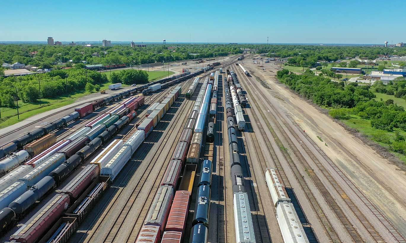 An aerial view of cargo trains lining the railway in Temple, Texas.