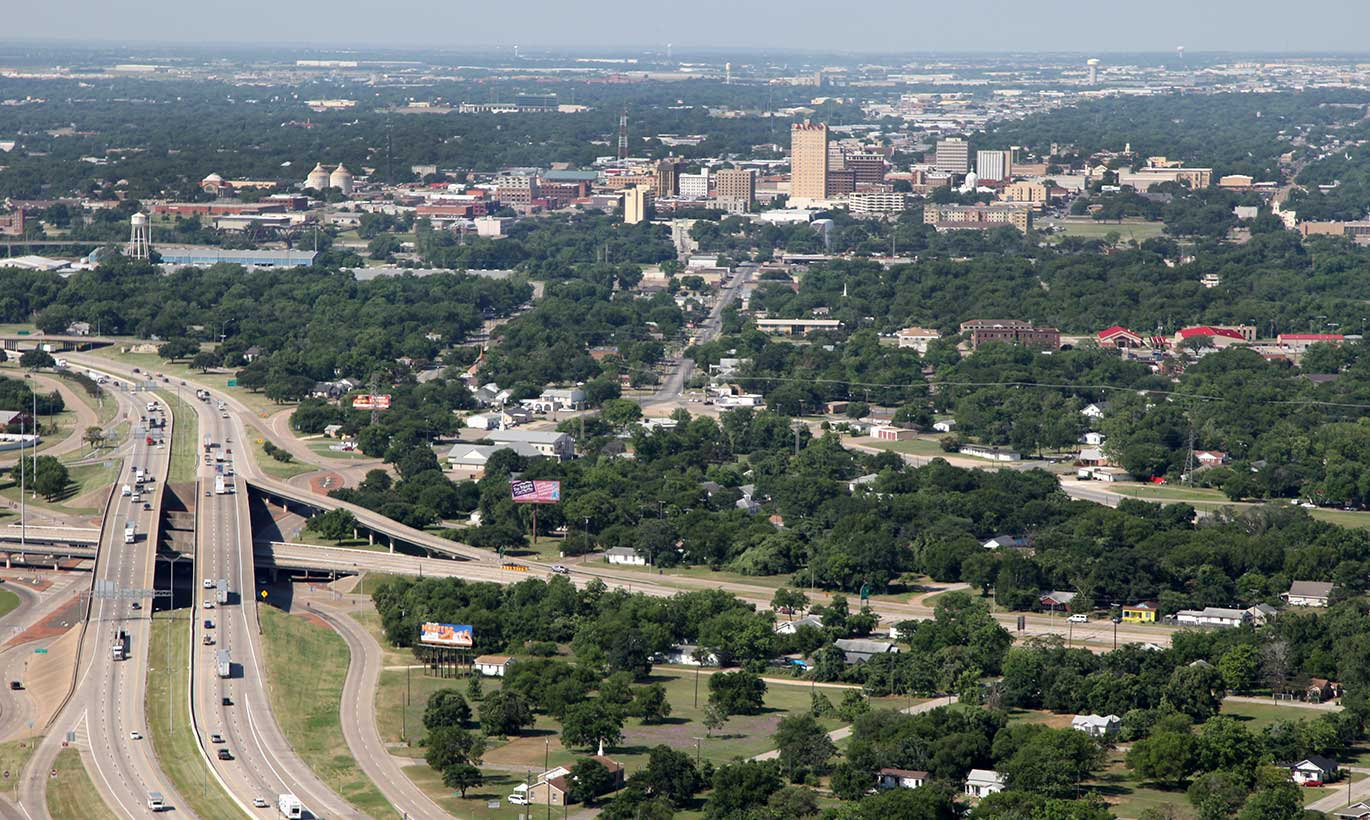 Aerial view of the highway and forests in Waco, Texas.