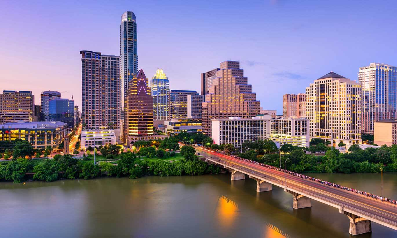 The Austin, Texas skyline lit up during sunset.