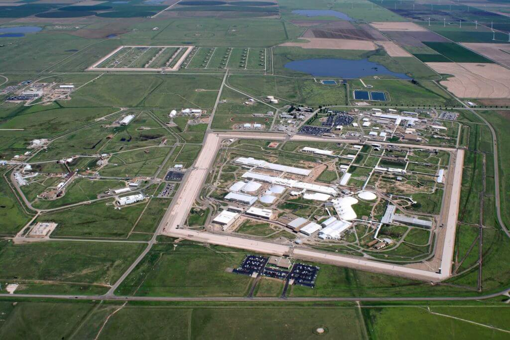 Aerial view of manufacturing facilities in Amarillo, Texas, surrounded by green grassy areas.