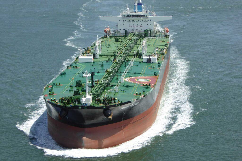 A large tanker ship moving through the ocean