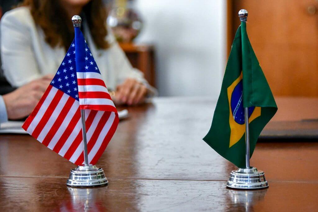 A tabletop US flag and Brazilian flag