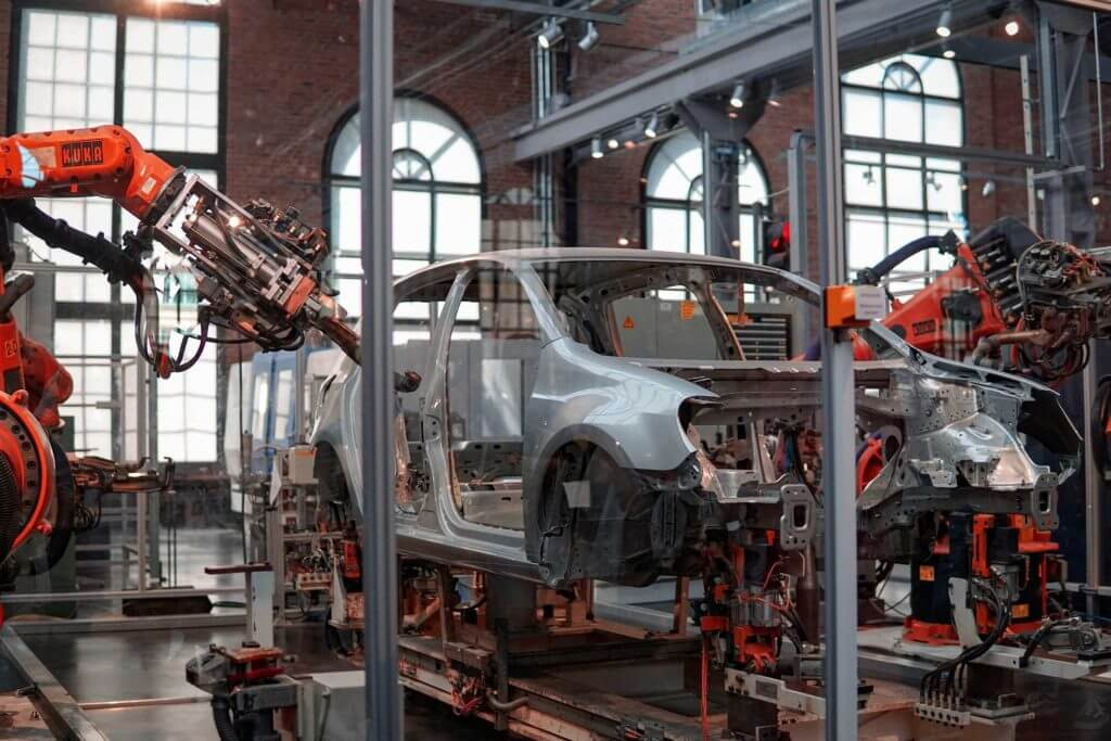 A car being assembled by robots