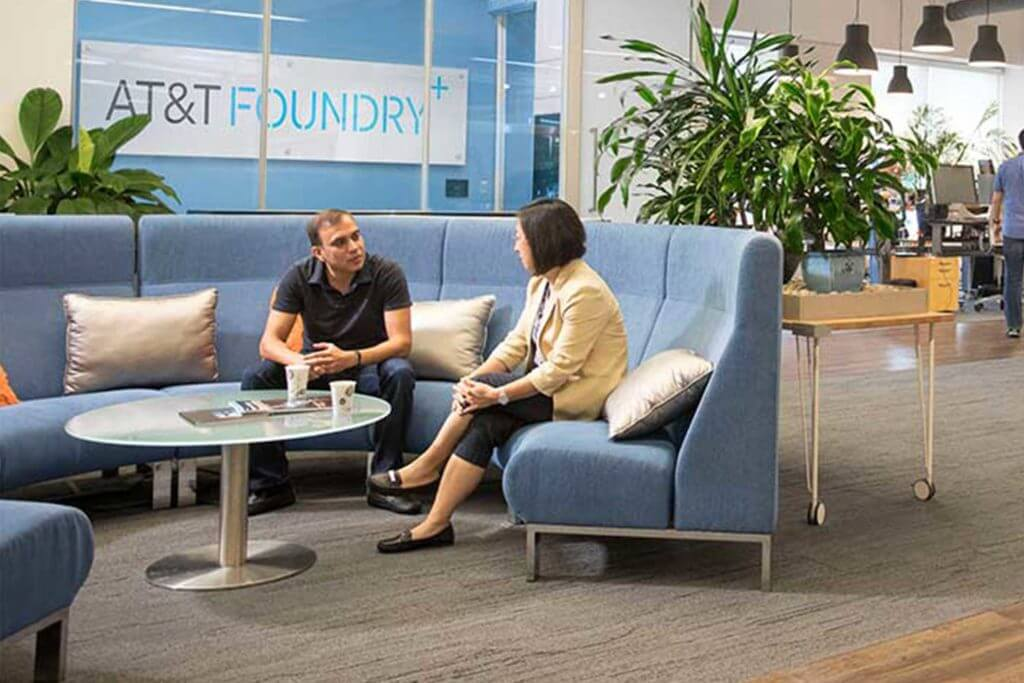 AT&T employees sit and have conversations at the AT&T Foundy Innovation Center in Plano, Texas.