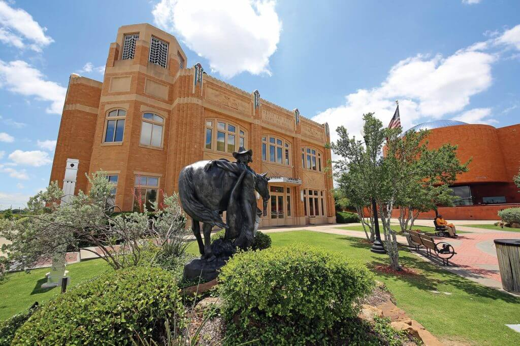 A statue of a cowgirl sits outside the entrance to the Cowgirl Hall of Fame & Museum in Fort Worth, Texas.
