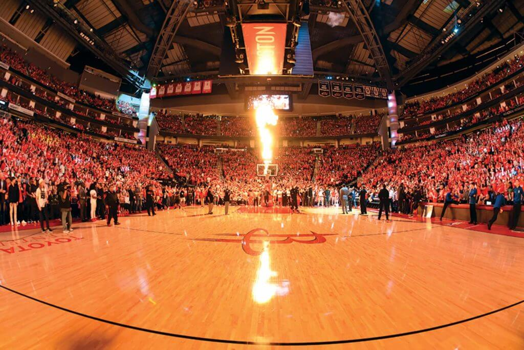 The Houston Rockets arena fills with fans as a backboard and hoop ignite with flames in Houston, Texas.