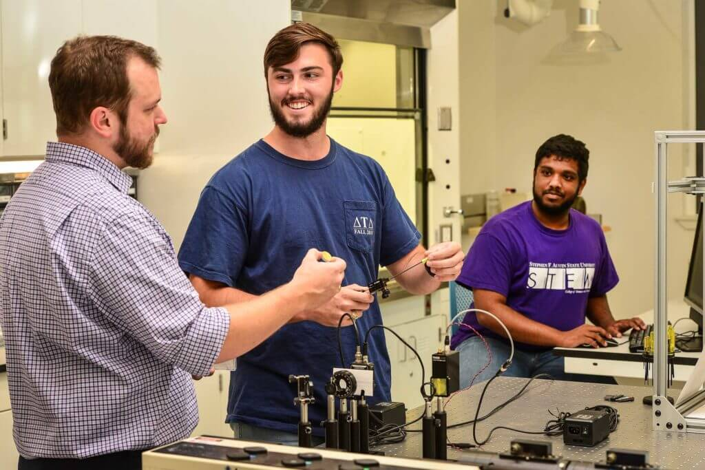 STEM students at Stephen F. Austin State University work together with equipment in Nacogdoches, Texas.