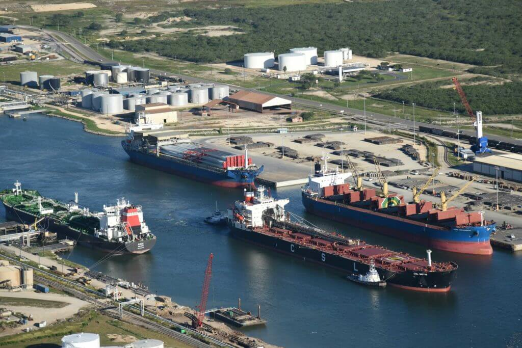 Multiple cargo ships dock at the Port of Brownsville in Texas.
