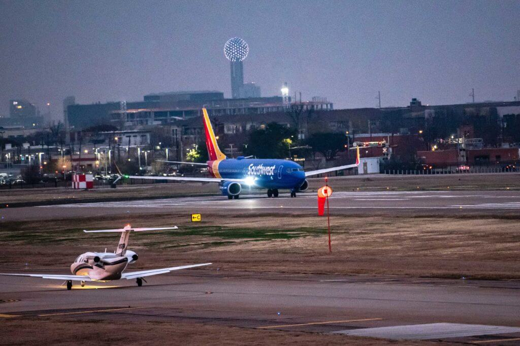 A Southwest plane lands on the tarmac