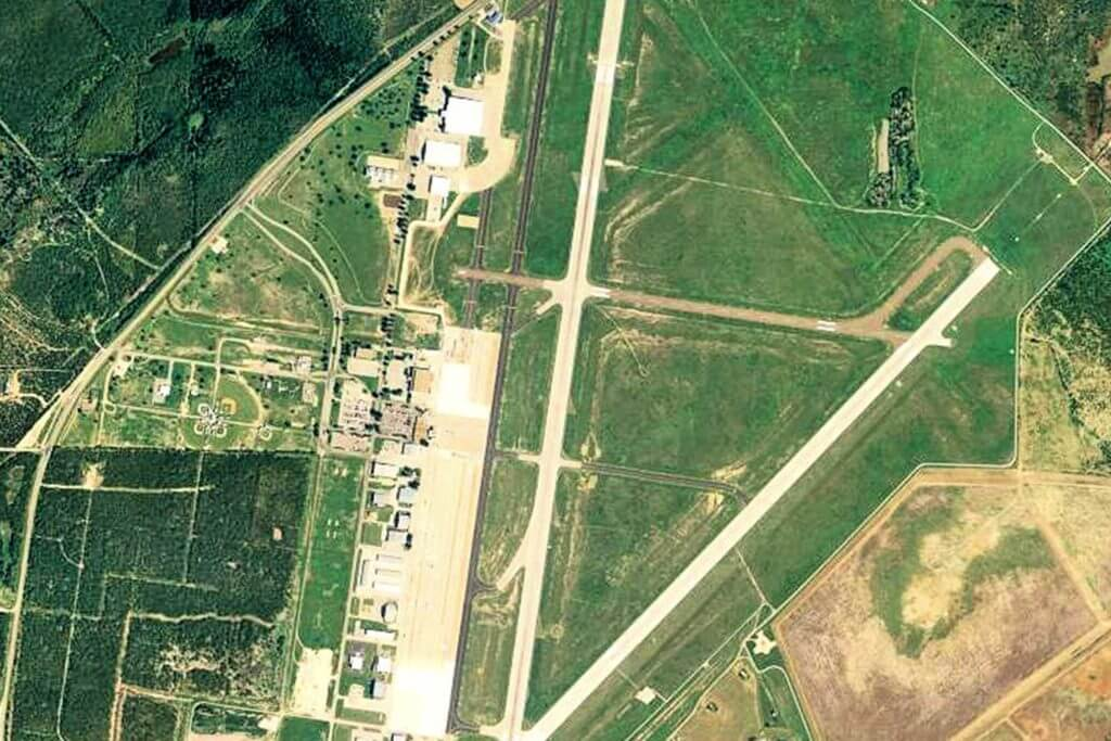 Aerial view of San Angelo Regional Airport, featuring large runways.