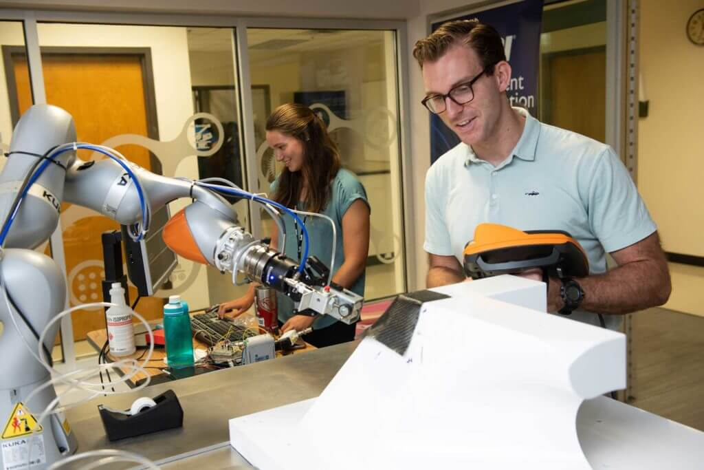 A man and woman work with robotics equipment at the Southwest Research Institute in San Antonio, Texas.
