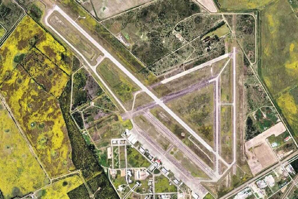 Aerial view of Victoria Regional Airport, including the long runways and airplanes.