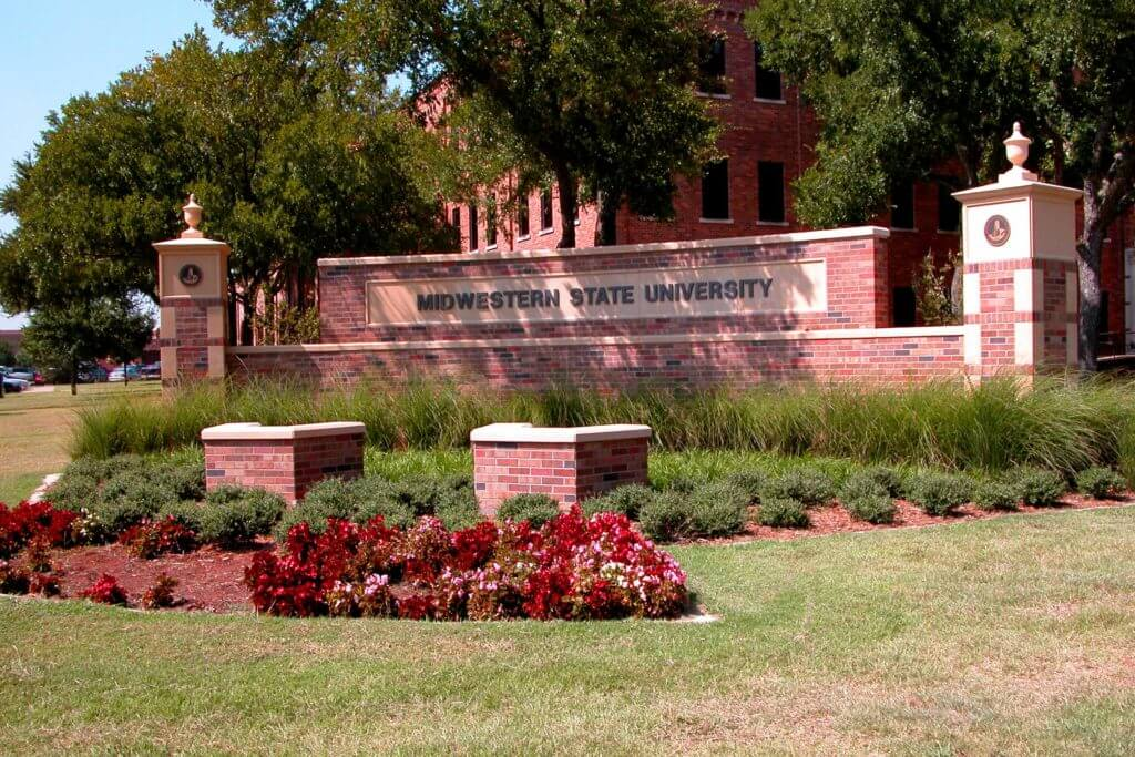 """A large brick sign reads """"Midwestern State University."""""""