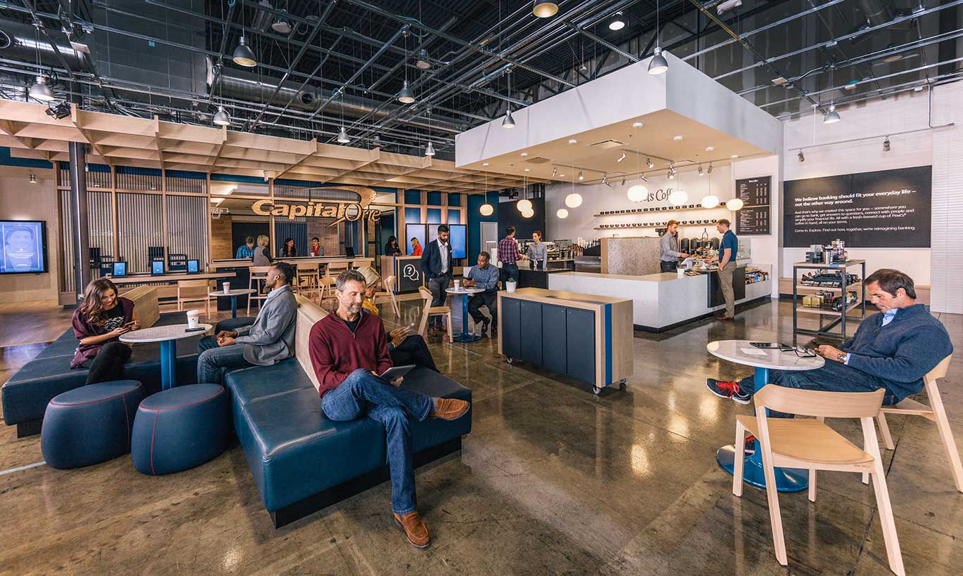 Businesspeople network and eat lunch in the Capital One cafe