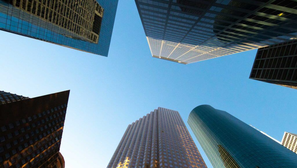 A shot looking up at skyrise buildings in Houston, Texas.